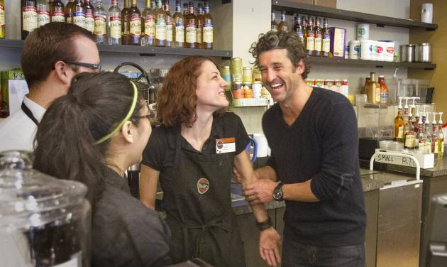 """FILE - In this Jan. 4, 2013 file photo, Patrick Dempsey meets the staff at the Tully's Coffee on Western Avenue near the Pike Place Market in Seattle. A bankruptcy judge of Friday, Jan. 13 approved the sale the beleaguered coffee company to a group led by Dempsey. The actor dubbed """"McDreamy"""" in the """"Grey's Anatomy"""" hospital TV drama had claimed victory last week after an auction. (AP Photo/The Seattle Times, Mike Siegel, File) OUTS: SEATTLE OUT, USA TODAY OUT, MAGAZINES OUT, TELEVISION OUT, SALES OUT. MANDATORY CREDIT TO: MIKE SIEGEL/THE SEATTLE TIMES."""