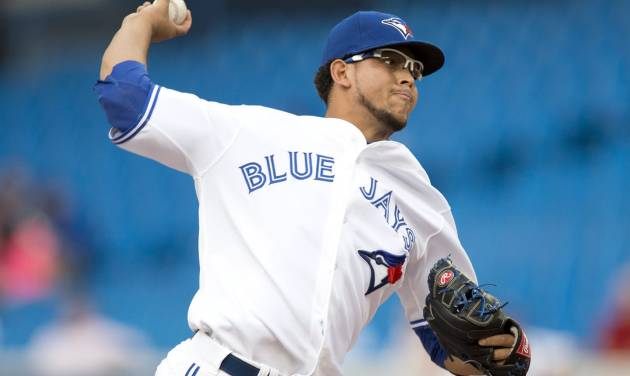 Toronto Blue Jays starting pitcher Henderson Alvarez pitches to the Kansas City Royals during the first inning of a baseball game in Toronto on Thursday, July 5, 2012. (AP Photo/The Canadian Press, Frank Gunn)