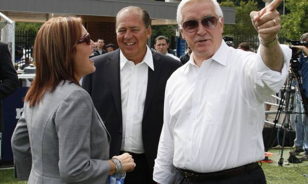 Pennsylvania Governor Tom Corbett, right, visits with West Virginia Governor Earl Ray Tomblin, center, and Ohio Lt. Governor Mary Taylor while attending a rally to support American energy and jobs in the coal and related industries at Highmark Stadium in downtown Pittsburgh, Wednesday, July 30, 2014. The rally is being held the day before the Environmental Protection Agency conducts public hearings on its new emissions regulations for existing coal fired power plants. (AP Photo/Gene J. Puskar)