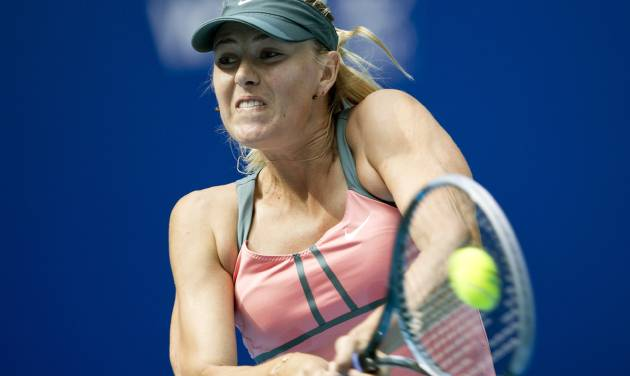 Russia's Maria Sharapova hits a backhand shot to Polona Hercog of Slovenia during their women's singles tennis match of the China Open tennis tournament in Beijing Thursday, Oct. 4, 2012. Sharapova defeated Hercog 6-0, 6-2. (AP Photo/Andy Wong)