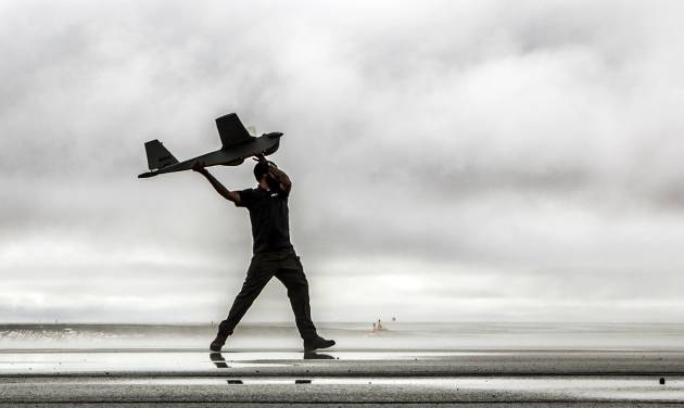 In this undated photo provided by AeroVironment, a man hand-launches a Puma drone aricraft. The Federal Aviation Administration (FAA) said Tuesday, June 10, 2014 it has granted the first permission for commercial drone flights over land, the latest effort by the agency to show it is loosening restrictions on commercial uses of the unmanned aircraft. Drone maker AeroVironment of Monrovia, Calif., and BP energy corporation have been given permission to use a Puma drone to survey pipelines, roads and equipment at Prudhoe Bay in Alaska, the agency said. The first flight took place on Sunday. The Puma is a small, hand-launched craft about 4 1/2 feet long and with a 9-foot wingspan. It was initially designed for military use. (AP Photo/AeroVironment)