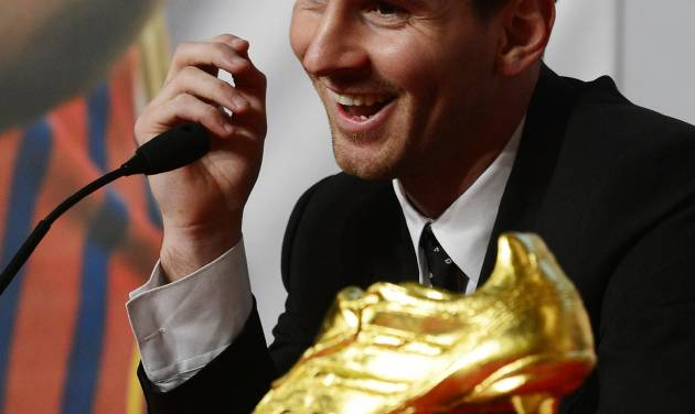 FC Barcelona's Lionel Messi from Argentina smiles during a news conference after receiving his Golden Boot award in recognition for scoring the most goals in Europe's domestic leagues last season, in Barcelona, Spain, Monday, Oct. 29, 2012. The 25-year-old Messi scored a Spanish-league record 50 goals for Barcelona, edging out fellow Spanish league star Cristiano Ronaldo of Real Madrid by four goals. (AP Photo/Manu Fernandez)