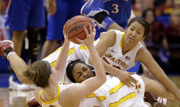Iowa State' Hallie Christofferson, bottom, grabs a loose ball on the floor with help from teammate Brynn Williamson, top, against Kansas' Catherine Williams, center, in the second half of an NCAA college basketball game in the Big 12 women's tournament on Saturday, March 9, 2013, in Dallas. Iowa State won 77-62. (AP Photo/Tony Gutierrez)