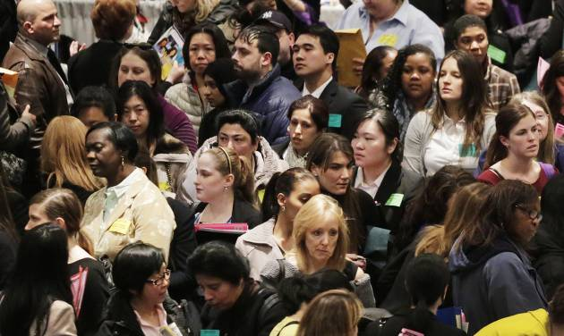 FILE - In this Thursday, March 14, 2013, file photo, a crowd of job seekers attends a healthcare job fair, in New York. The government reports on JOLTS -- the Job Openings and Labor Turnover Survey -- for March on Tuesday, May 7, 2013. (AP Photo/Mark Lennihan)