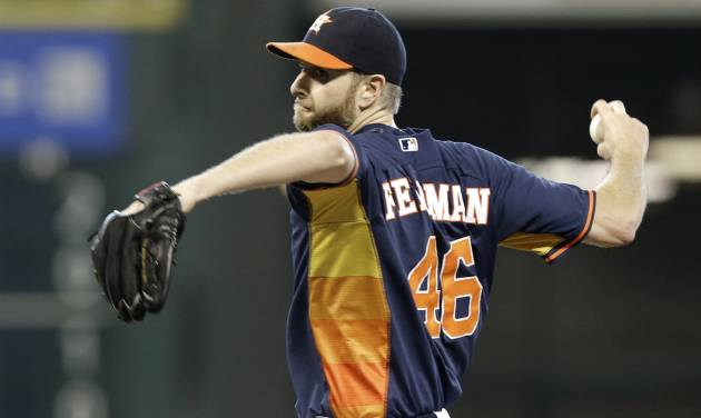 Houston Astros' Scott Feldman pitches against the Detroit Tigers in the first inning of a baseball game Sunday, June 29, 2014, in Houston. (AP Photo/Pat Sullivan)