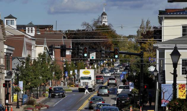 A pedestrian crosses Route 1 in downtown Kennebunk, Maine, Friday, Oct. 12, 2012. Curious residents in this seaside community may have to wait to learn which of their friends and neighbors stand accused of giving business to a fitness instructor charged with running a prostitution operation out of her Zumba studio. The police department's plan to release some of the more than 150 names of suspected clients was delayed Friday by last-minute legal wrangling. Alexis Wright, a 29-year-old fitness instructor from Wells, Maine, has pleaded not guilty to prostitution, invasion of privacy and other charges for allegedly accepting money for sex and secretly videotaping her encounters. Her business partner, Mark Strong Sr., a 57-year-old insurance agent and private investigator from Thomaston, Maine, pleaded not guilty to 59 misdemeanor charges.(AP Photo/Robert F. Bukaty)