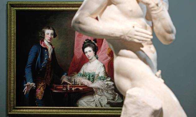 """Francis Cotes' painting named """"Portrait of William Welby and his wife Penelope Playing Chess"""" (1769) and Antonio Canova's sculpture named """"The Pugilists Creugas and Damoxenos"""" (1797-1803) are displayed as part of the exhibition """"Louvre Abu Dhabi. Birth of a Museum"""", at the Louvre museum, in Paris, Monday, April 28, 2014. The Louvre Abu Dhabi, the Persian Gulf's first ever world museum, will open its doors in December 2015 in the arid Arab federation. Several thousand kilometers away on Tuesday the Louvre in Paris previewed the art that the Abu Dhabi project has acquired since 2009 for the first time to a European audience. (AP Photo/Thibault Camus)"""