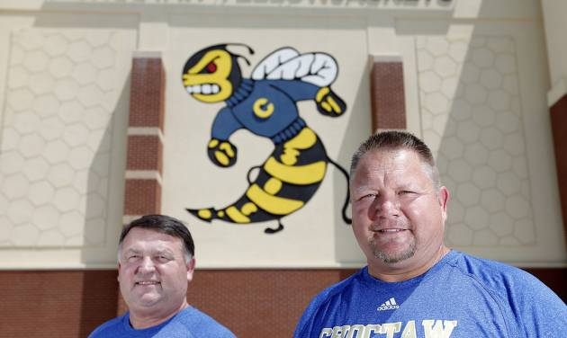 Choctaw head coach Todd Dilbeck, right, and offensive coordinator Ty Prestidge pose for a photo, Sunday, Aug 11, 2013. Photo by Sarah Phipps, The Oklahoman