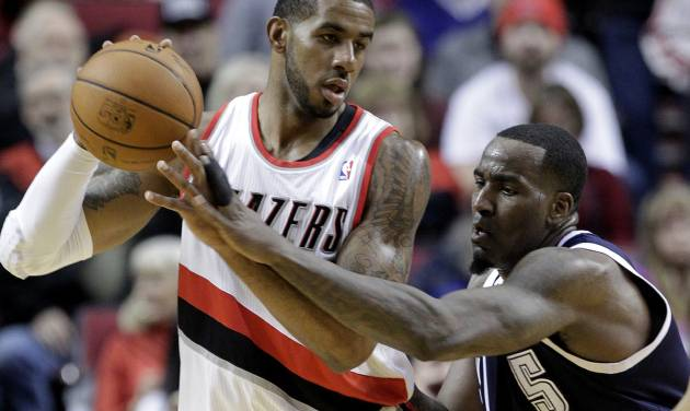 Oklahoma City Thunder center Kendrick Perkins, right, reaches in on Portland Trail Blazers forward LaMarcus Aldridge during the first half of an NBA basketball game in Portland, Ore., Tuesday, Feb. 11, 2014. (AP Photo/Don Ryan)