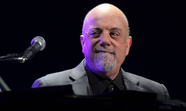 FILE - In this Monday, Jan. 27, 2014, file photo, Billy Joel performs the first show of his Madison Square Garden residency, in New York. Baby boomers Joel, Maria Shriver and Samuel L. Jackson will be among those featured in an upcoming PBS documentary about the post-World War II generation. (Photo by Greg Allen/Invision/AP, File)