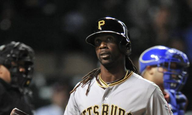 Pittsburgh Pirates' Andrew McCutchen walks away after striking out during the seventh inning of a baseball game against the Chicago Cubs in Chicago, Wednesday, April 9, 2014. Chicago won 7-5. (AP Photo/Paul Beaty)