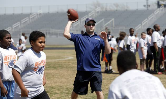 Denver Broncos' Wes Welker throws a ball during the Wes Welker pro camp at Douglass High School in  Oklahoma City., Saturday, April 05, 2014. Photo by Sarah Phipps, The Oklahoman