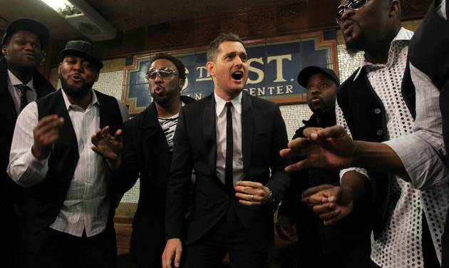 "In this photo provided by Transit Wireless, Canadian Crooner Michael Buble, center, and the acappella group Naturally 7 perform a song from Buble's just released album ""To Be Loved"" In this photo provided by Transit Wireless, Michael Buble, center, and the acappella group Naturally 7 perform a song from Buble's just released album ""To Be Loved"" Thursday April 25, 2013 at an underground subway station in New York.  The performance was to promote public awareness of the availability of wireless and Wi-Fi in underground New York City subway stations. Cell phone service and free Wi-Fi have arrived at another 30 New York City subway stations.The Metropolitan Transportation Authority announced the expansion Thursday of a program that started with six stations in 2011.(AP Photo/Transit Wireless, Tina Fineberg)"