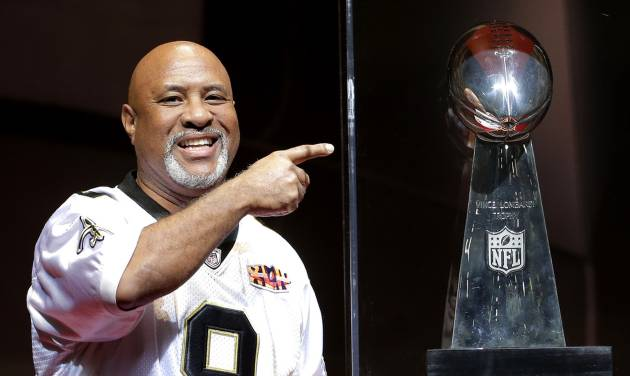 Harold Broussard, from New Orleans, points to the Vince Lombardi trophy as he attends the NFL experience Wednesday, Jan. 30, 2013, in New Orleans. The city will host the Super Bowl XLVII football game Sunday. (AP Photo/Charlie Riedel)