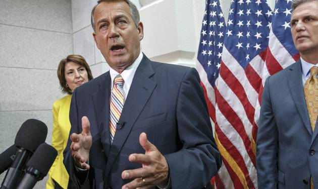 Speaker of the House John Boehner of Ohio, flanked by Rep. Cathy McMorris Rodgers, R-Wash., left, and incoming Majority Leader Rep. Kevin McCarthy, R-Calif., right, speaks to reporters on Capitol Hill in Washington, Tuesday, July 29, 2014, following a Republican strategy session. Boehner discussed various topics including that he dismisses suggestions that Republicans are planning to impeach President Barack Obama. (AP Photo/J. Scott Applewhite)