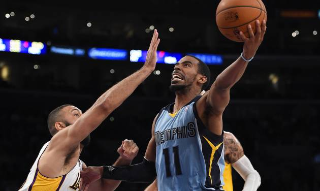 Memphis Grizzlies guard Mike Conley, right, puts up a shot as Los Angeles Lakers guard Kendall Marshall defends during the second half of an NBA basketball game, Sunday, April 13, 2014, in Los Angeles. The Grizzlies won 102-90. (AP Photo/Mark J. Terrill)