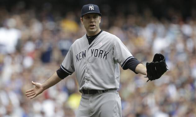 New York Yankees starting pitcher David Phelps reacts to a balk called on him in the third inning of a baseball game against the Milwaukee Brewers Sunday, May 11, 2014, in Milwaukee. (AP Photo/Jeffrey Phelps)