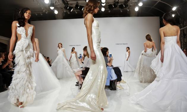 In this April 18, 2016 photo, fashion from the Christian Siriano bridal collection is modeled in New York. (AP Photo/Bebeto Matthews)