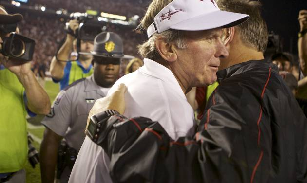 South Carolina coach Steve Spurrier, left, is congratulated by Georgia coach Mark Richt following South Carolina's 35-7 victory in an NCAA college football game at Williams-Brice Stadium in Columbia, S.C., Saturday, Oct. 6, 2012. (AP Photo/Brett Flashnick)