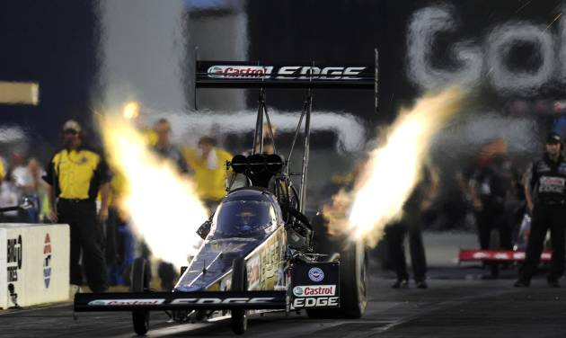 In this photo provided by NHRA, Top Fuel driver Brittany Force drives to the provisional qualifying lead Friday, July 25, 2014, at the NHRA Sonoma Nationals drag races in Sonoma, Calif. (AP Photo/NHRA, Marc Gewertz)