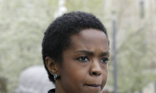 "Singer Lauryn Hill walks from federal court in Newark, N.J., Monday, April 22, 2013, after a judge postponed her  tax evasion sentencing and scolded the eight-time Grammy winner for reneging on a promise to make restitution. Hill pleaded guilty last year to not paying federal taxes on $1.8 million earned from 2005 to 2007. At that time, her attorney said she would pay more than $500,000 by the time of her sentencing. It was revealed Monday in court that Hill has paid $50,000. The South Orange resident got her start with The Fugees and began her solo career in 1998 with the acclaimed album ""The Miseducation of Lauryn Hill."" (AP Photo/Mel Evans)"