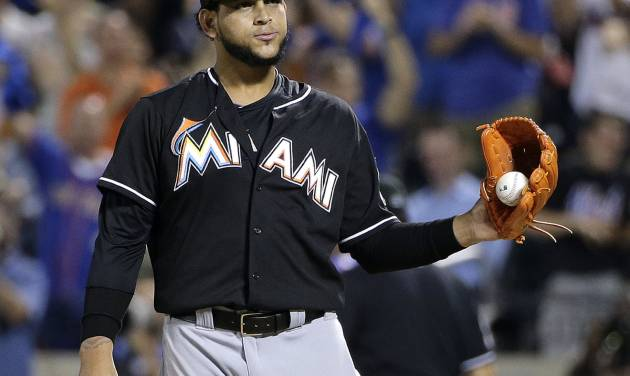 Miami Marlins pitcher Henderson Alvarez reacts after giving up a two-run home run to New York Mets' David Wright in the fifth inning of a baseball game, Friday, July 11, 2014, in New York. (AP Photo/Julie Jacobson)