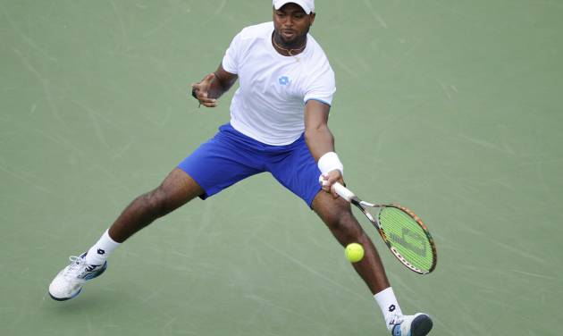 Donald Young reaches for the ball against Kevin Anderson, of South Africa, during a match at the Citi Open tennis tournament, Friday, Aug. 1, 2014, in Washington. (AP Photo/Nick Wass)