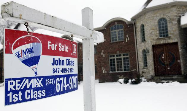 """In this Wednesday, Feb. 27, 2013, photo, a """"for sale"""" sign is seen outside a home in Glenview, Ill. U.S. sales of previously occupied homes rose in February to the highest level in more than three years, further evidence of a sustained housing recovery that is benefiting the broader economy. (AP Photo/Nam Y. Huh)"""