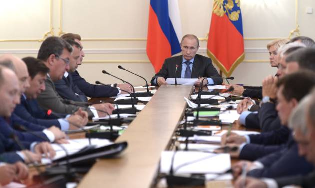 Russian President Vladimir Putin, background center, heads the Cabinet meeting in the Novo-Ogaryovo residence, outside Moscow, Russia, Wednesday, July 30, 2014. The meeting focused on measures to encourage Russian companies to pull their assets back from offshore. The United States and the European Union on Tuesday announced a raft of new sanctions against Russian companies and banks over Moscow's support for separatists in Ukraine. (AP Photo/RIA Novosti, Alexei Nikolsky, Presidential Press Service)