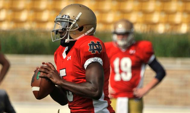 Notre Dame quarterback Everett Golson sprints out at practice during media day for the NCAA college football team Tuesday Aug. 19, 2014, in South Bend, Ind. (AP Photo/Joe Raymond)