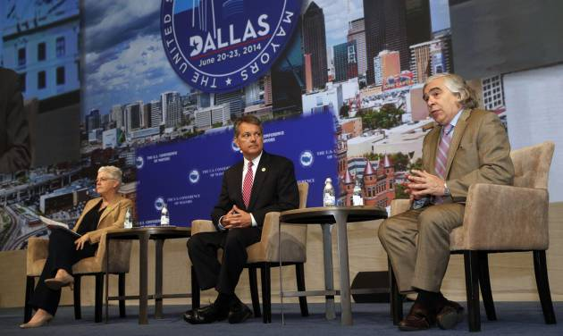 """Ernest Moniz, right, secretary, United States Deptartment of Energy, discusses climate protection with Gina McCarthy, ledt,  United States Environmental Protection Agency, and David Agnew at the U.S. Conference of Mayors at the Omni Hotel in Dallas,  on June 22, 2014. Attendees of the U.S. Conference of Mayors voted Sunday to sign the U.S. Mayors Climate Protection Agreement in Dallas, on Sunday, June 22, 2014. The resolution encourages cities to use natural solutions to """"protect freshwater supplies, defend the nation's coastlines, maintain a healthy tree cover and protect air quality,"""" sometimes by partnering with nonprofit organizations. The resolution only """"encourages"""" steps rather than mandating action. (AP Photo/The Dallas Morning News, Michael Ainsworth) MANDATORY CREDIT; MAGS OUT; TV OUT; INTERNET USE BY AP MEMBERS ONLY; NO SALES"""