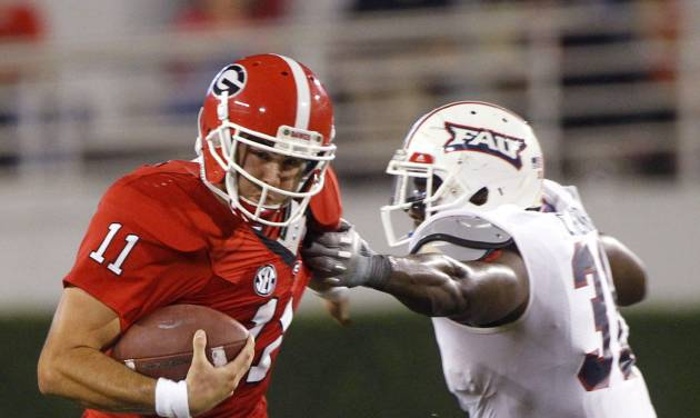 Georgia quarterback Aaron Murray (11) breaks away from Florida Atlantic linebacker Cory Henry (31) in the second half of an NCAA college football game Saturday, Sept. 15, 2012, in Athens, Ga. (AP Photo/John Bazemore)
