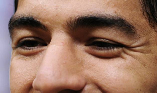 FC Barcelona's Luis Suarez, from Uruguay, smiles during a press conference at  his presentation at the Camp Nou in Barcelona, Spain, Tuesday, Aug. 19, 2014. (AP Photo/Manu Fernandez)