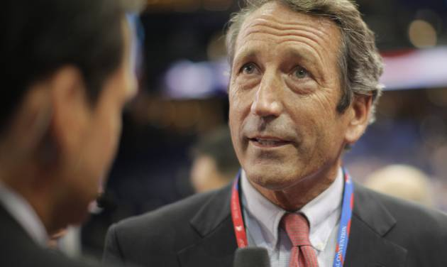 FILE - In this Aug. 28, 2012 file photo, former South Carolina Gov. Mark Sanford talks to a reporter in the floor at the Republican National Convention in Tampa, Fla. Nearly four years after his affair with an Argentine woman was exposed, Sanford plans to announce his return to politics and run for his old congressional seat on Wednesday, Jan. 16, 2013. (AP Photo/Charles Dharapak, File)