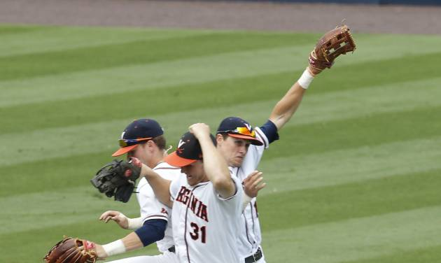 Virginia outfielders Derek Fisher, left, Joe McCarthy (31) and Brandon Downes (10) celebrate after Virginia's 10-1 win over Bucknell in an NCAA college baseball tournament regional game in Charlottesville, Va., Friday, May 30, 2014. (AP Photo/Steve Helber)