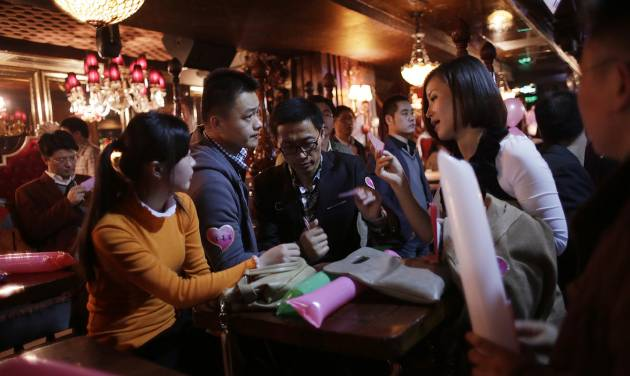 """Participants who are singles introduce themselves during a matchmaking party organized by one of the biggest Chinese matchmaking websites in Shanghai, China on Sunday Nov. 11, 2012. Singles Day was begun by Chinese college students in the 1990s as a version of Valentine's Day for people without romantic partners. The timing was based on the date Nov. 11, or """"11.11"""" — four singles. Unattached young people would treat each other to dinner or give gifts to woo that special someone and end their single status. (AP Photo/Eugene Hoshiko)"""