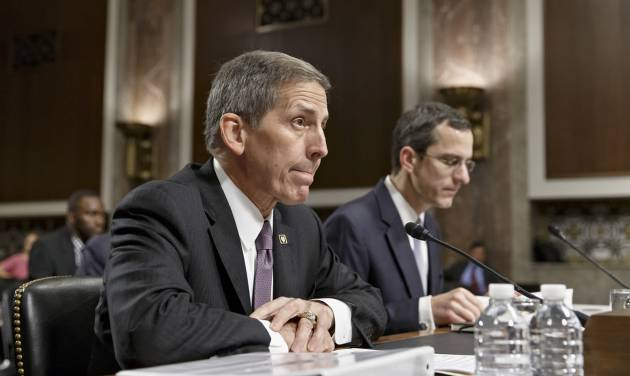 Veterans Affairs acting Secretary Sloan Gibson testifies on Capitol Hill in Washington, Wednesday, July 16, 2014, before the Senate Veterans' Affairs Committee hearing on the state of VA health care in the wake of revelations of neglect and delayed medical visits. He is accompanied by Assistant Deputy Undersecretary For Health For Administrative Operations Philip Matkowsky.   (AP Photo/J. Scott Applewhite)
