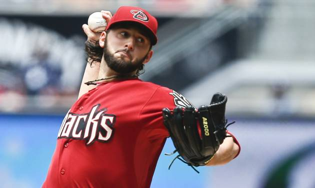 Arizona Diamondbacks starting pitcher Mike Bolsinger throws against the San Diego Padres during the first inning of a baseball game, Sunday, June 29, 2014, in San Diego.  (AP Photo/Lenny Ignelzi)