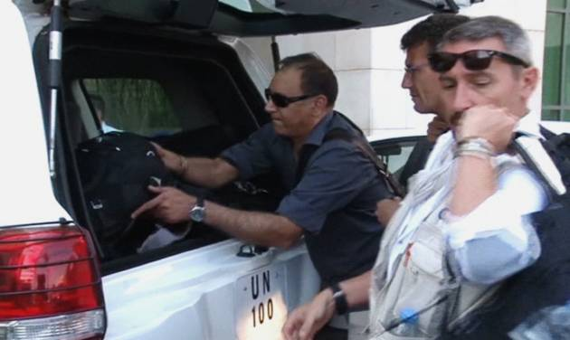 In this image made from video, U.N. weapon inspectors collect their luggage from their U.N. vehicle as they arrive at a hotel in Damascus, Syria, Sunday, Aug. 18, 2013. A team of U.N. weapons inspectors arrived in Damascus on Sunday for a long-delayed mission to investigate the alleged use of chemical arms in Syria's civil war. (AP Photo/AP Video)