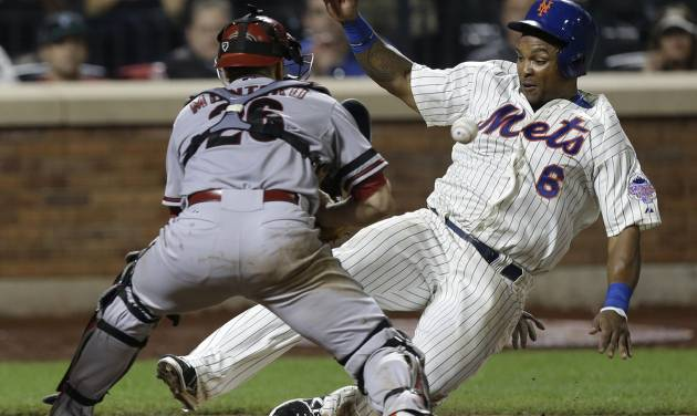 New York Mets' Marlon Byrd, right, slides safely home past Arizona Diamondbacks catcher Miguel Montero to tie the game during the ninth inning of the baseball game at Citi Field, Monday, July 1, 2013, in New York. (AP Photo/Seth Wenig)