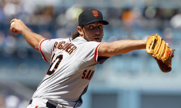 San Francisco Giants starting pitcher Madison Bumgarner delivers against the Los Angeles Dodgers in the first inning in a baseball game on Saturday, April 5, 2014, in Los Angeles. (AP Photo/Alex Gallardo)