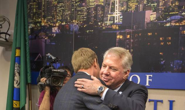 Seattle Mayor Ed Murray, right, is congratulated after announcing his proposed phased-in increase of the city's minimum wage to $15 an hour over the next seven years, Thursday, May 1, 2014 in Seattle. (AP Photo/The Seattle Times, Steve Ringman)   SEATTLE OUT; USA TODAY OUT; MAGS OUT; TELEVISION OUT; NO SALES; MANDATORY CREDIT TO BOTH THE SEATTLE TIMES AND THE PHOTOGRAPHER