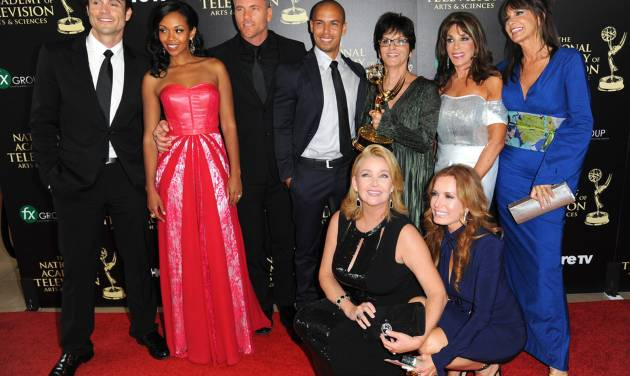 """The cast and crew of """"The Young and the Restless"""" poses in the press room with the award for outstanding drama series at the 41st annual Daytime Emmy Awards at the Beverly Hilton Hotel on Sunday, June 22, 2014, in Beverly Hills, Calif. (Photo by Richard Shotwell/Invision/AP)"""