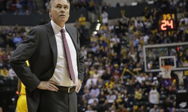 Los Angeles Lakers head coach Mike D'Antoni looks in the direction of the scoreboard while playing the Indiana Pacers during the second half of an NBA basketball game in Indianapolis, Tuesday, Feb. 25, 2014. The Pacers won 118-98. (AP Photo/AJ Mast)