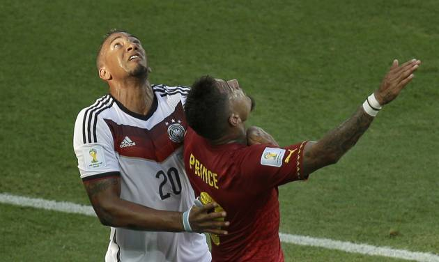 Germany's Jerome Boateng, left, and his half-borther Ghana's Kevin-Prince Boateng look up to the ball during the group G World Cup soccer match between Germany and Ghana at the Arena Castelao in Fortaleza, Brazil, Saturday, June 21, 2014. (AP Photo/Themba Hadebe)