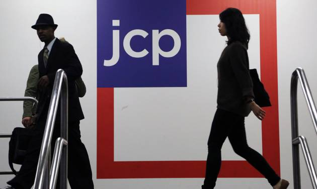 FILE - In this Tuesday, April 9, 2013 file photo, customers shop at a J.C. Penney store, in New York. J.C. Penney Co. reports quarterly financial results before the market opens Thursday, Aug. 14, 2014. (AP Photo/Mark Lennihan, File)