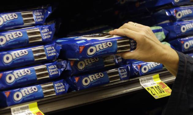 FILE - In this Feb. 9, 2011 file photo, a shopper selects Oreo cookies at a Ralphs Fresh Fare supermarket in Los Angeles. Mondelez International Inc. reports quarterly financial results after the market closes on Wednesday, Feb. 12, 2014. (AP Photo/File)