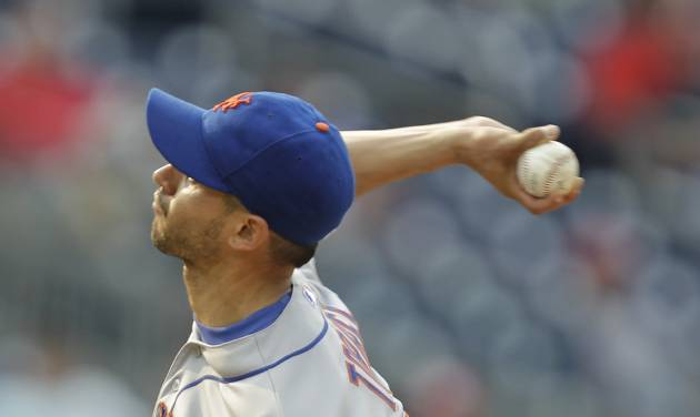 New York Mets pitcher Carlos Torres delivers a pitch during the thirteenth inning of a baseball game against the Washington Nationals, Thursday, Aug. 7, 2014, in Washington. The Nationals won 5-3 in  thirteen innings (AP Photo/Luis M. Alvarez)