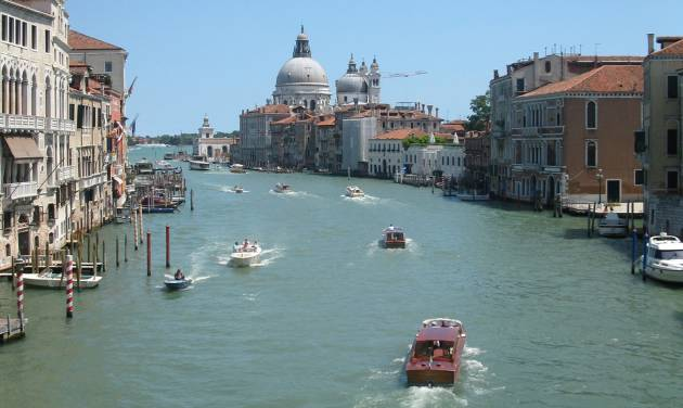 This July 17, 2012 photo shows water traffic bustling on the Grande Canale in the heart of Venice, Italy. To travel through northern Italy with a copy of Mark Twain's 1869 ''The Innocents Abroad', his classic 'record of a pleasure trip'. It took him to the great sights of Europe and on to Constantinople and Jerusalem before he sailed home to New York. Such a trip would take far too big a chunk out of my holiday time. But, Milan, Florence and Venice, a mere fragment for Twain, was within my reach for a two-week vacation. (AP Photo/Raf Casert)