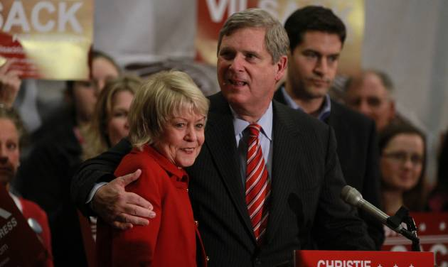 Fourth district Democratic congressional candidate Christie Vilsack gets a hug from her husband Secretary of Agriculture Tom Vilsack as the two address supporters at supporters during an election night party on Tuesday, Nov. 6, 2012 at the Gateway Center in Ames, Iowa. Vilsack was defeated by Republican Rep. Steve King. (AP Photo/The Des Moines Register, Charlie Litchfield) NO SALES